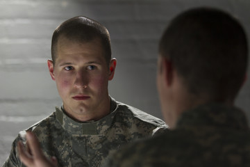 Shell-shocked soldier consoled by peer, horizontal