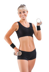 beautiful sports woman holding dumbbells isolated
