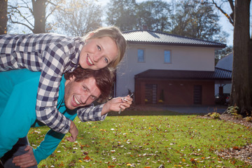 Happy couple with a new house