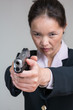 Woman aiming a hand gun