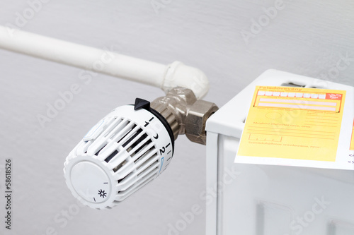 heating thermostat with cash pay check, expensive heating costs