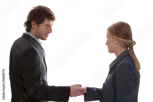 Man shaking woman hand