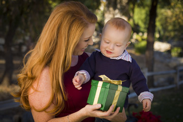 Beautiful Young Mother and Baby with Christmas Gift