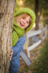 Portrait of Cute Young Girl Wearing Green Scarf and Hat