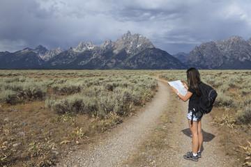 Girl reading map in Grand Teton National Park