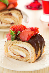 Chocolate swiss roll cake with strawberries