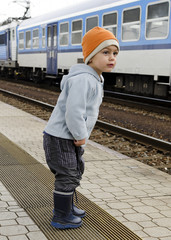 Child at train station
