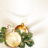 Christmas background with baubles and fir tree branches on a cle