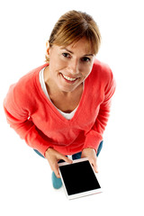 Aerial shot of a lady using tablet pc