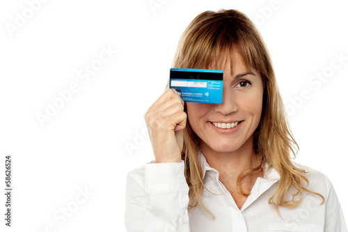 Lady hiding his eye with credit card