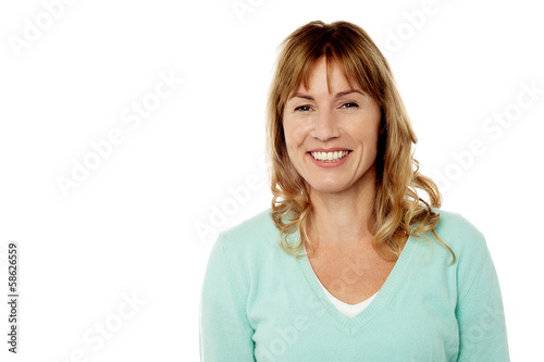 Smiling lady posing casually