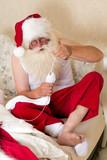 Santa Claus doing mending socks