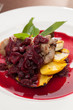 meat with mango and cherry sauce