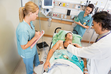 Doctor Defibrillating Critical Patient In Hospital