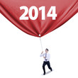 Businessman pulls new year banner