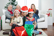 Father And Children With Presents During Christmas