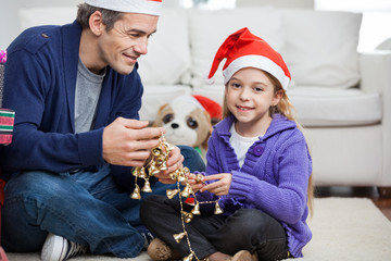 Girl With Father Holding Christmas Ornaments