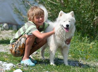 Boy hugging a fluffy dog