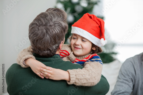 Son Embracing Father During Christmas