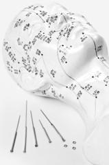 Akupunkturnadeln mit Kopfmodell