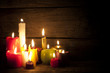 Candles in night in christmas mood on vintage wooden boards