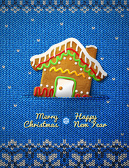 Christmas gingerbread house cookie on knitted background