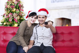 Happy christmas couple at home