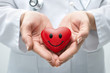 Doctor holding smiling heart
