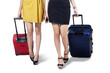 Isolated two woman with suitcase