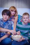Three friends watching movie