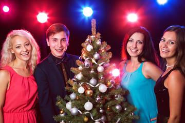 Happy people around the Christmas tree