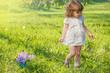 Preschool girl in a garden