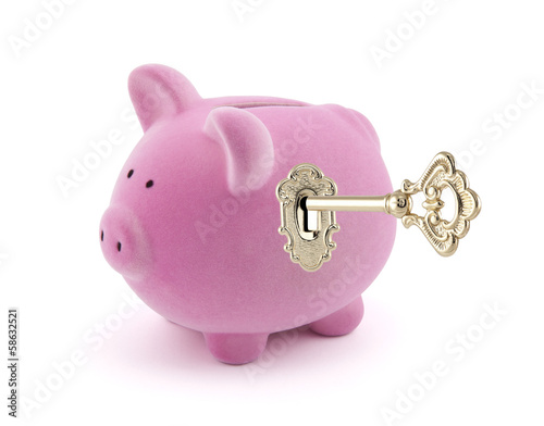 Piggy bank with golden key