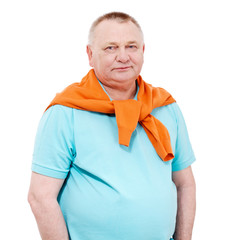 Senior man with orange sweater over white