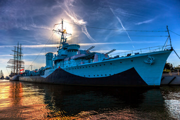 Warship in the port of dramatic scenery. Gdynia, Poland.
