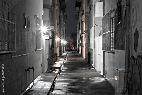 Dark back alley on a wet night © sas