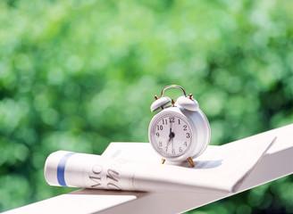 alarm clock and newspaper