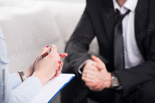 psychiatrist examining a male patient - 58636355