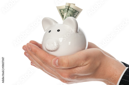 Holding piggy bank