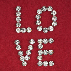 """The word """" love"""" made by with rhinestones"""