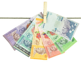 Malaysia Bank Notes money hanging on a clothes line
