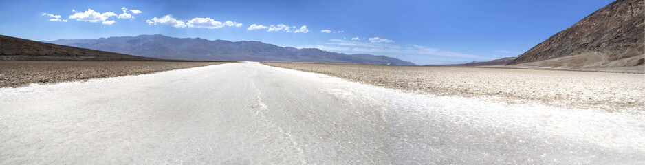 white salt road and mountains - wide shot