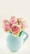 Pink roses in a blue vase