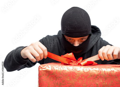 bandit holding a wrapped Christmas gift - 58641731