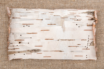 Birch bark on burlap background