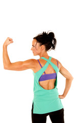 Woman flexing one arm looking sideways other hand on hip