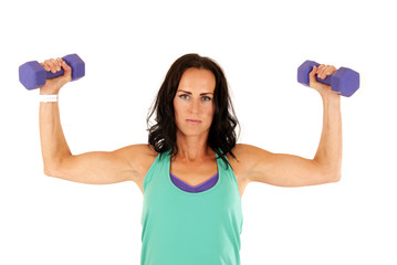 woman showing off her muscles lifting purple barbells