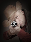 Cowboy with shotgun aiming at you. Gun control concept. poster