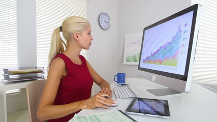 Business woman using computer and tablet