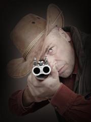Cowboy with shotgun aiming at you. Gun control concept.